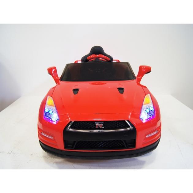 Электромобиль Nissan красный